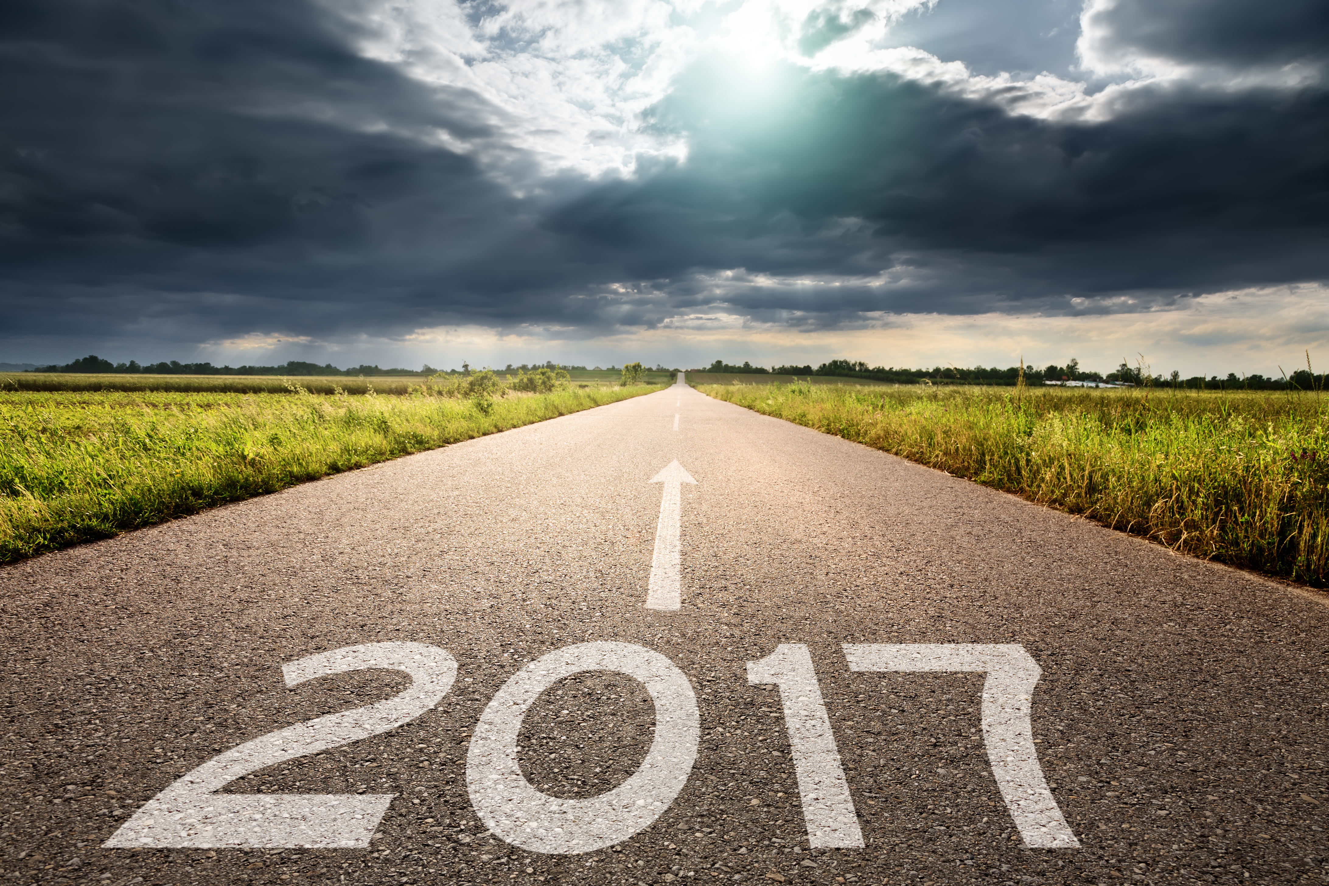 Empty road to upcoming 2017 against the big cloud